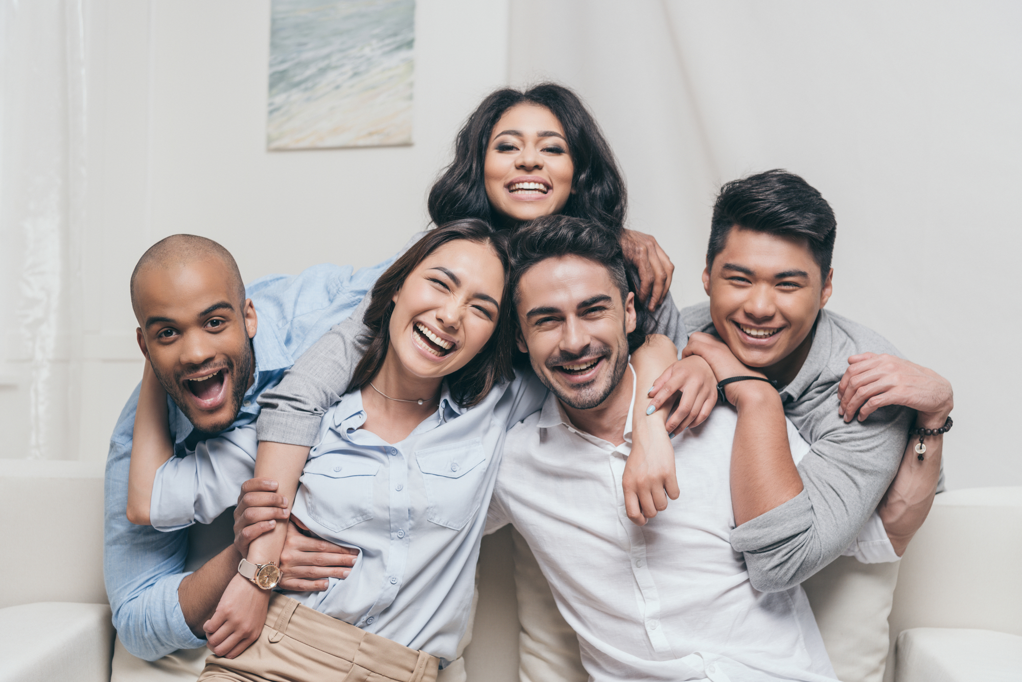 Young cheerful multiethnic friends